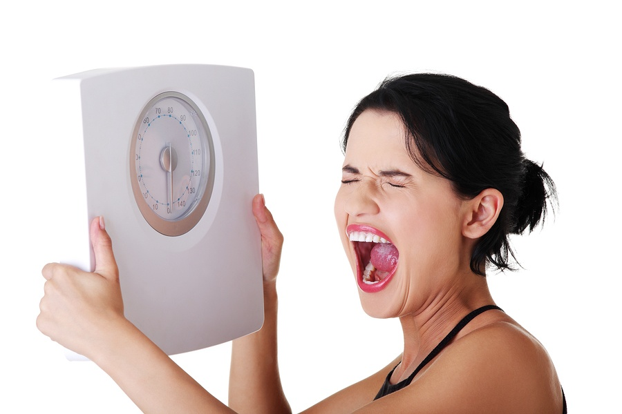 bigstock-Frustrated-woman-with-scale-i-39025033.jpg